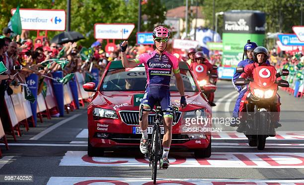 """Lampre Merida's Italian cyclist Valerio Conti celebrates winning as he crosses the finish line during the 13th stage of the 71st edition of """"La..."""