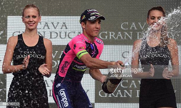 """Lampre-Merida's Italian cyclist Valerio Conti celebrates on the podium after winning the 13th stage of the 71st edition of """"La Vuelta"""" Tour of Spain,..."""