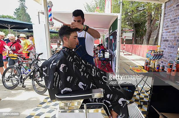 """Lampre-Merida's Italian cyclist Valerio Conti has his hair cut before the 16th stage of the 71st edition of """"La Vuelta"""" Tour of Spain, a 158km route..."""