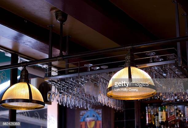 lamps and glasses in bar - lyn holly coorg imagens e fotografias de stock