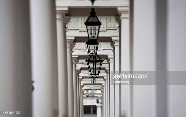 Lamps hang in the entrance porches of homes and offices on Eaton Place in the Kensington district of London UK on Wednesday Oct 29 2014 UK house...