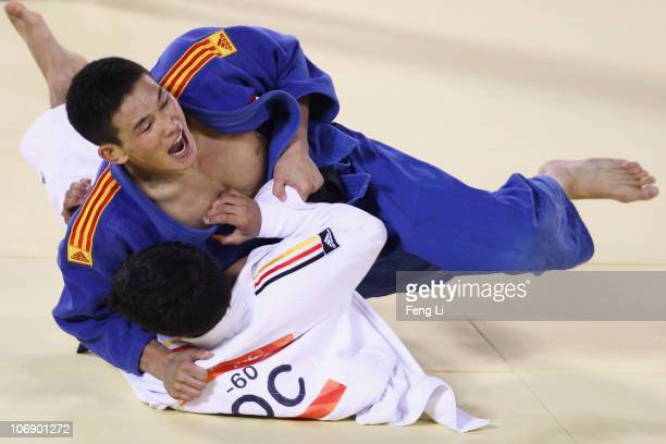 Lamusi of China competes against Ahmadtya Aldheyabi of IOC in the men's judo 60kg preliminary contest at the Huagong Gymnasium during day four of the...