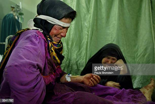 Lamya Uoda cries with her motherinlaw at her side in the emergency room at the Al Jarmouk hospital after Uoda suffered a schrapnel wound when US...