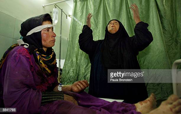 Lamya Uoda sits in the emergency room at the Al Jarmouk hospital with her motherinlaw at her side after Uoda suffered a schrapnel wound when US...