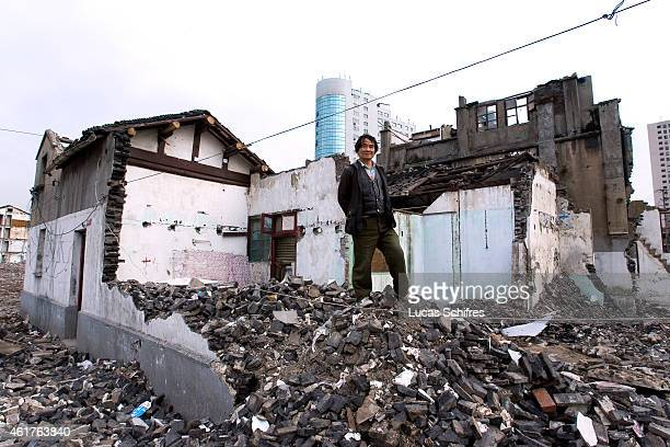 Lan Guixiao stands on rubble of his house halfdemolished on April 2 2010 in Shanghai China Lan Guixiao's house is a 'nailhouse' ie the last remaining...