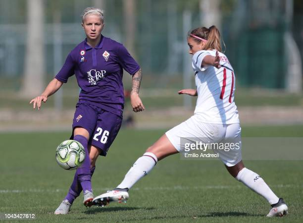 Lana Clelland of Fiorentina Women's FC is challenged by Nora Heroum of AC Milan during the Serie A match between AC Milan Women and Fiorentina Women...