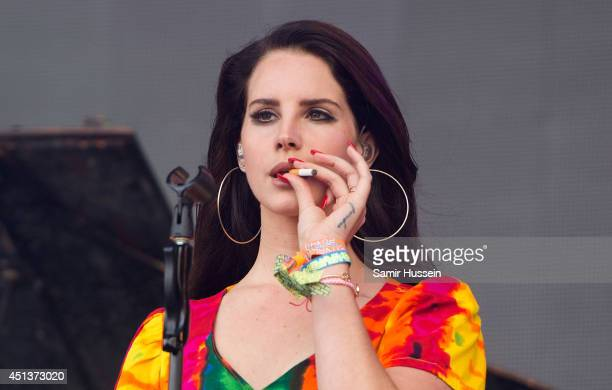 Lana Del Rey smokes as she performs on Day 2 of the Glastonbury Festival at Worthy Farm on June 28 2014 in Glastonbury England