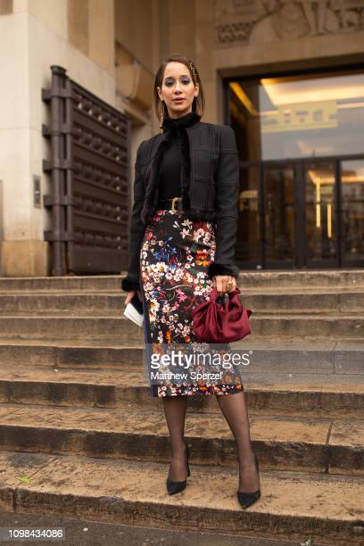 Lana El Sahely is seen attending Elie Saab during Paris Haute Couture Fashion Week wearing Elie Saab skirt with black jacket and red bag on January...