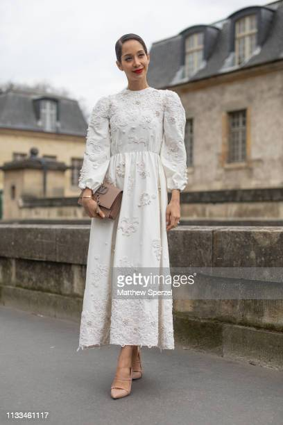 Lana El Sahely is seen on the street attending VALENTINO during Paris Fashion Week AW19 wearing VALENTINO white dress on March 03, 2019 in Paris,...