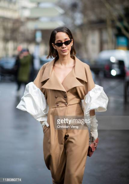 Lana El Sahely is seen wearing beige overall with wide white sleeves gloves outside Miu Miu during Paris Fashion Week Womenswear Fall/Winter...