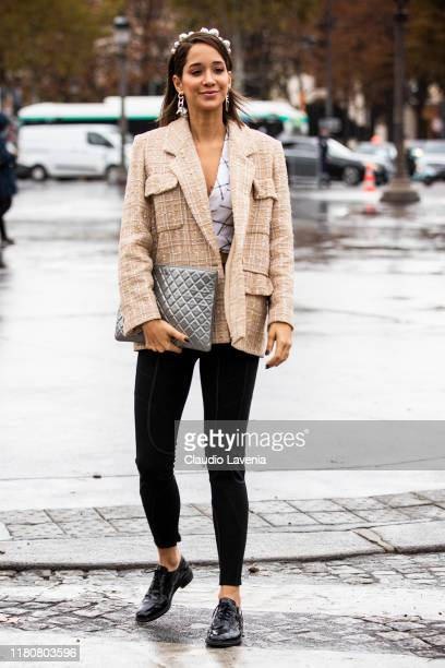 Lana El Sahely wearing a beige blazer silver bag black pants and black shoes is seen outside the Chanel show during Paris Fashion Week Womenswear...