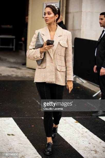 Lana El Sahely, wearing a beige Chanel decorated blazer, black pants and silver bag, is seen outside the Chanel show during Paris Fashion Week -...