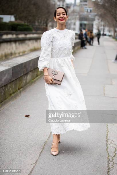 Lana El Sahely, wearing a long decorated dress, nude heels and nude bag, is seen outside Valentino on Day 7 Paris Fashion Week Autumn/Winter 2019/20...