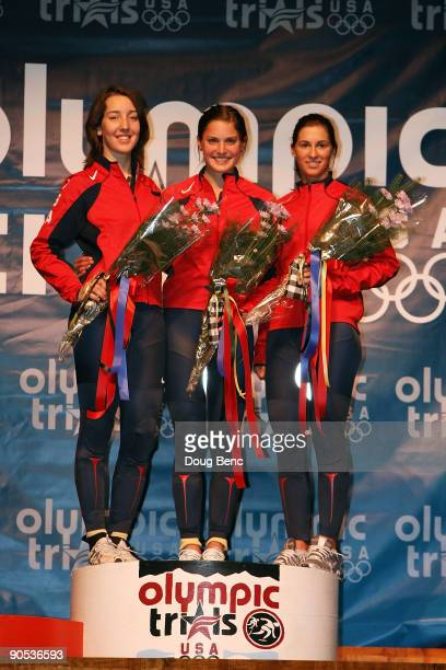 Lana Gehring in second place Alyson Dudek in first place and Kimberly Derrick in third place stand on the podium after the Women's 500 Meter Final at...