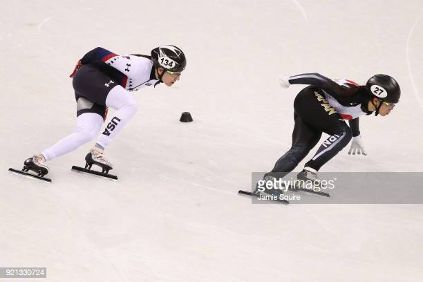 Lana Gehring of the United States and Sumire Kikuchi of Japan compete during the Ladies Short Track Speed Skating 1000m Heats on day eleven of the...