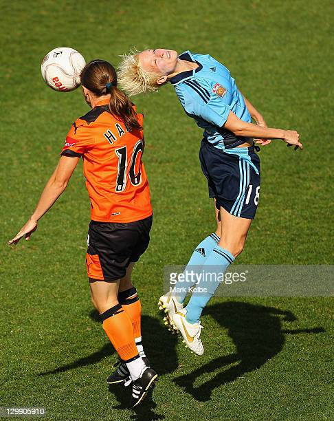 Lana Harch of the Roar competes for the ball with Megan Rapinoe of Sydney FC during the round one W-League match between Sydney FC and Brisbane Roar...