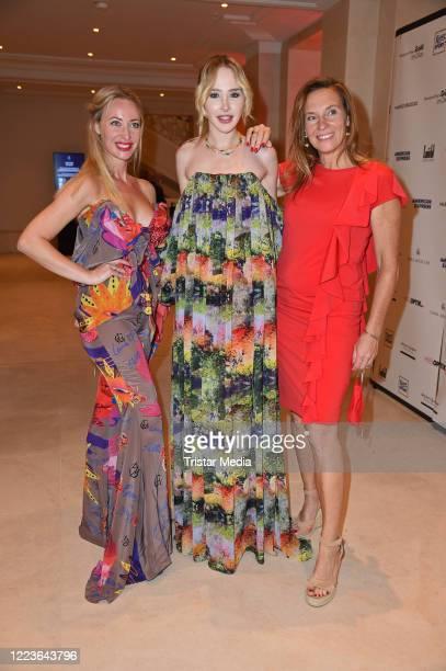 "Lana Mueller, Theresia Fischer and Anja Gockel attend the Anja Gockel Fashion Show Sommer 2021 ""ASUKA - Der Duft von morgen"" at Hotel Adlon Kempinski..."