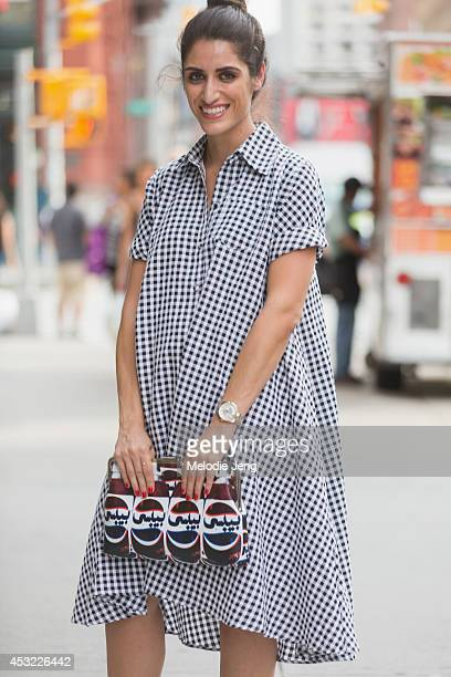 Lana Shamma wears a dress from London bag from Lebanon and United Nude shoes in July 2014 in New York City
