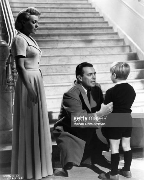 Lana Turner John Forsythe and Teddy Quinn in a scene from the Universal Pictures drama 'Madame X'