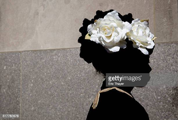 Lana Turner wears a bonnet during the Easter Parade and Bonnet Festival along 5th Avenue March 27 2016 in New York City The parade is a New York...