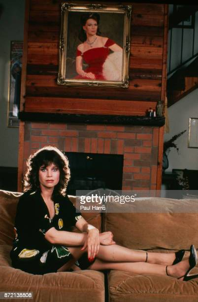 Lana Wood Natalie Woods sister sister photographed at home with a portrait of Natalie on the wall November 17 1991