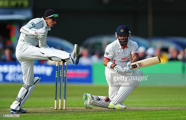 Lancashire batsman Ashwell Prince in action as Middlesex keeper John Simpson attempts to stop the runs during day one of the LV County Championship...