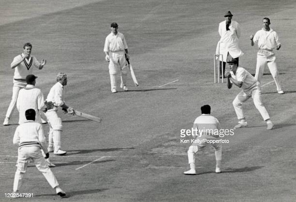 Lancashire batsman Barry Wood is caught for 3 runs by John Jameson of Warwickshire off the bowling of Bob Barber during the County Championship match...