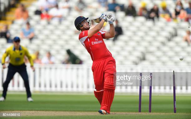 Lancashire batsman Liam Livingstone has his middle stump uprooted by a delivery from Keith Barker during the Natwest T20 Blast match between...