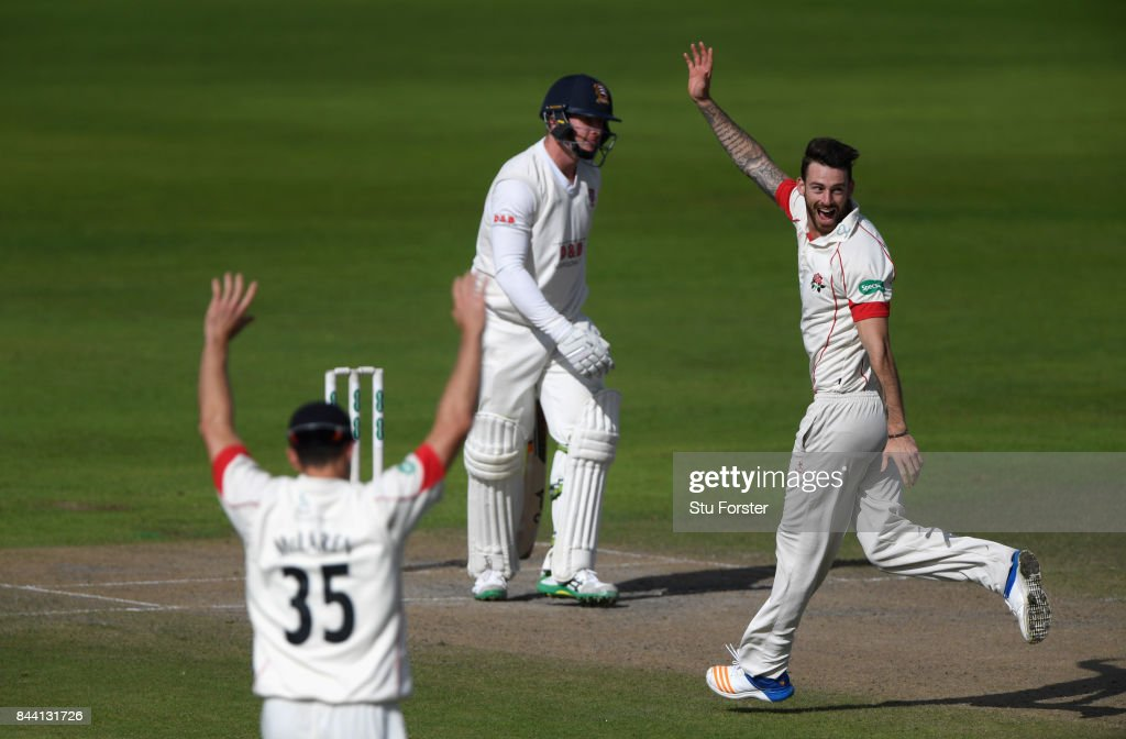 Lancashire bowler Jordan Clark takes the wicket of Essex batsman Simon Harmer lbw during day four of the Specsavers County Championship Division One match between Lancashire and Essex at Old Trafford on September 8, 2017 in Manchester, England.