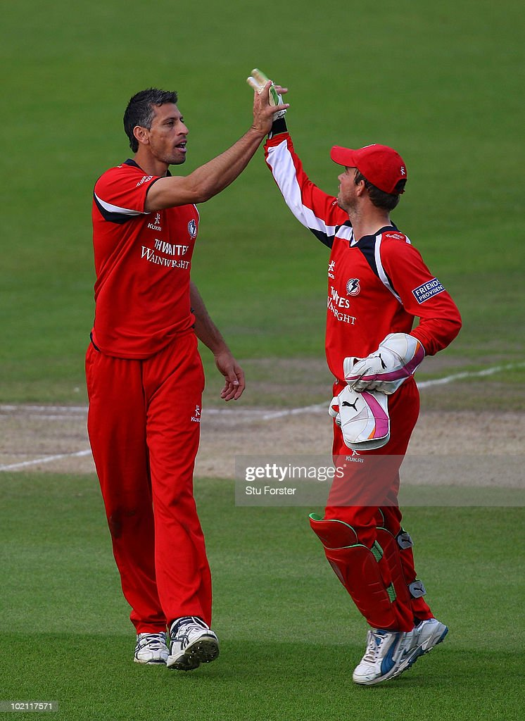 Lancashire bowler Sajid Mahmood (l) celebrates with wicketkeeper Gareth Cross after taking the wicket of David Hussey during the Friends Provident T20 match between Nottinghamshire and Lancashire at Trent Bridge on June 15, 2010 in Nottingham, England.