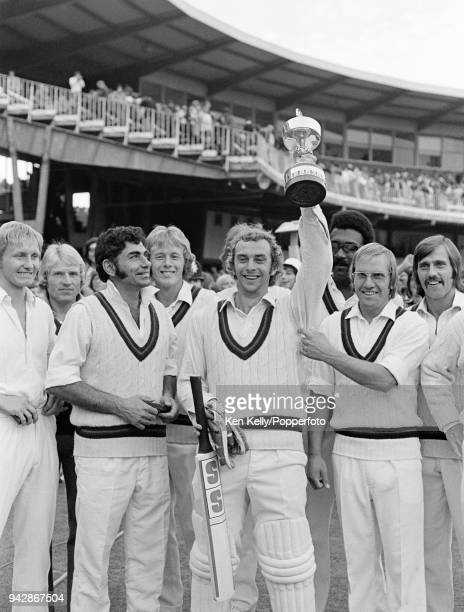 Lancashire captain David Lloyd holding the trophy aloft as he celebrates with his teammates after Lancashire beat Middlesex by 7 wickets in the...