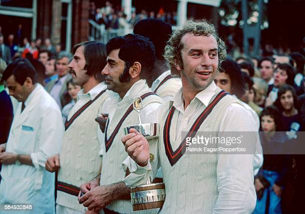 Lancashire captain David Lloyd holds the Gillette Cup after Lancashire won the Gillette Cup Final between Lancashire and Middlesex at Lord's Cricket...