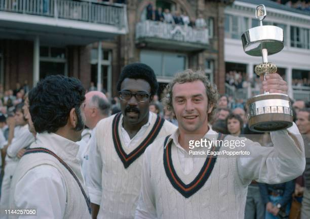 Lancashire captain David Lloyd lifts the Gillette Cup with teammates Farokh Engineer and Clive Lloyd after Lancashire beat Middlesex in the Gillette...