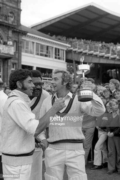 Lancashire captain David Lloyd playfully holds the Gillette Cup away from from team mates Farokh Engineer and Clive Lloyd