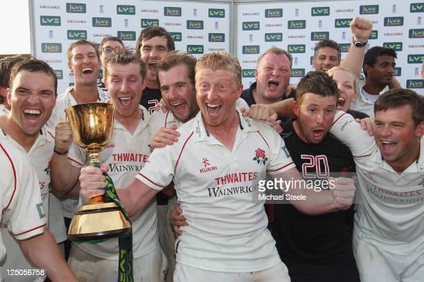 Lancashire captain Glenn Chapple leads the Championship winning celebrations during the LV County Championship match between Somerset and Lancashire...