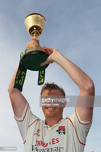 Lancashire captain Glenn Chapple lifts the Championship trophy during the LV County Championship match between Somerset and Lancashire at the County...