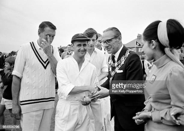 Lancashire captain Jack Bond is presented with a winner's cheque after Lancashire won the Player's County League match against Warwickshire at the...