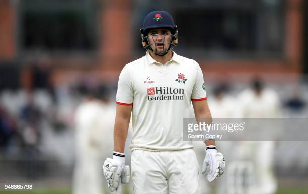 Lancashire captain Liam Livingstone leaves the field after being dismissed by Jake Ball of Nottinghamshire during the four day of Specsavers County...