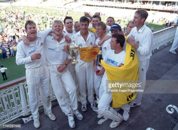 Lancashire captain Mike Watkinson and teammates celebrate on the pavilion balcony after winning the Benson and Hedges Cup Final between Lancashire...