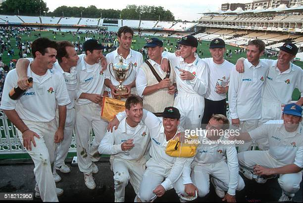 Lancashire captain Mike Watkinson celebrates with his team after winning the Benson and Hedges Cup Final between Kent and Lancashire at Lord's...