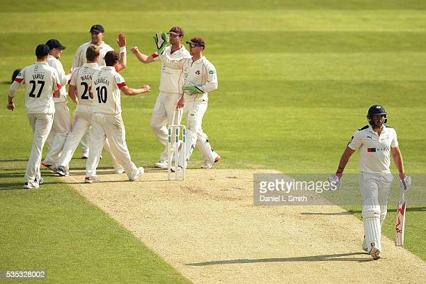 Lancashire celebrate the dismissal of Tim Bresnan of Yorkshire during day one of the Specsavers County Championship Division One match between...