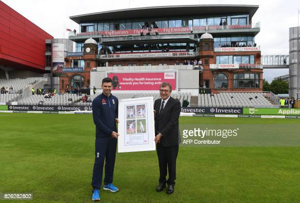 Lancashire County Cricket Club Chairman David Hodgkiss makes a presentation to England's James Anderson on the first day of the fourth test at Old...