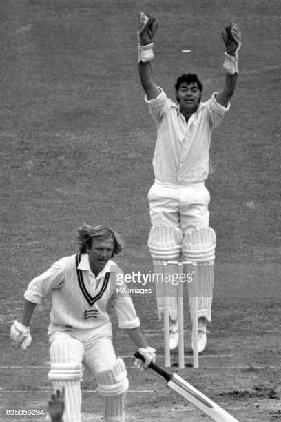 Lancashire wicketkeeper Farokh Engineer raises his arms in triumph as Middlesex's Clive Radley is out lbw for 15 runs