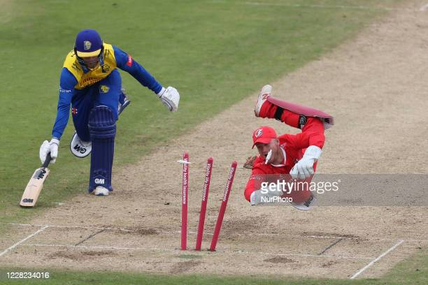Lancashire's Alex Davies runs out Durham's Graham Clark during the Vitality Blast T20 match between Durham County Cricket Club and Lancashire at...
