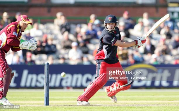 Lancashire's Paul Horton hits out past Northhamptonshire's wicket keeper Niall O'Brien during the Friends Provident Trophy match at Old Trafford...