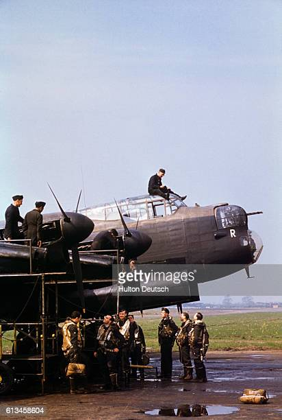 Lancaster bomber at a military field during WWII.