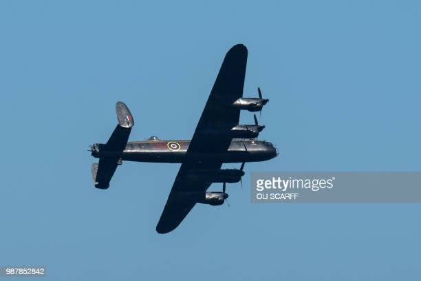 A Lancaster bomber flies during an aerial display at the national Armed Forces Day celebrations at Llandudno north Wales on June 30 2018 The annual...