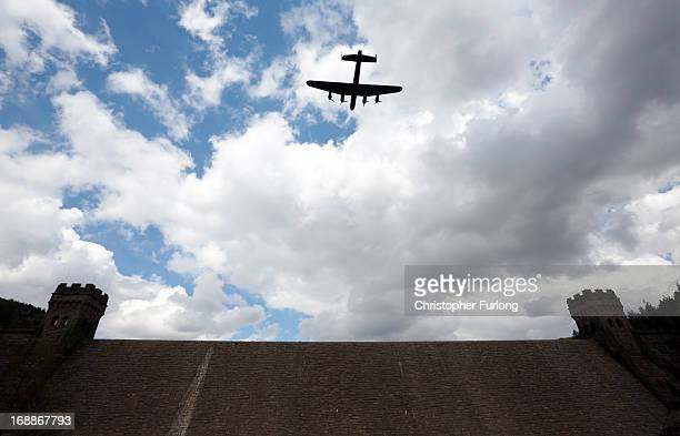 Lancaster bomber flies over Ladybower reservoir in the Derbyshire Peak District to mark the 70th anniversary of the World War II Dambusters mission...