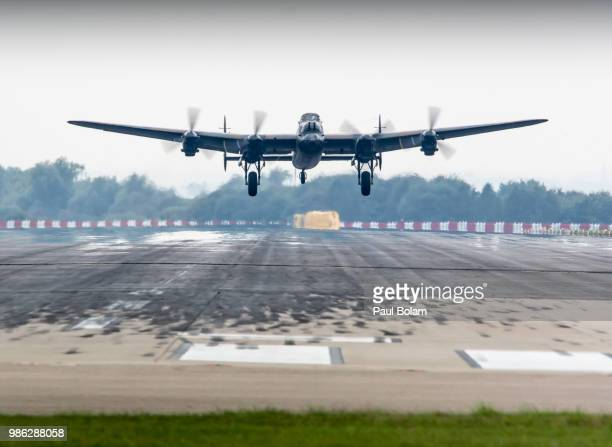lancaster bomber taking off - lancaster bomber stock pictures, royalty-free photos & images