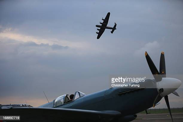 Lancaster Bomber 'The City of Lincoln' flys over a WWII Spitfire as they take part in a Sunset Ceremony to mark the 70th anniversary of the World War...